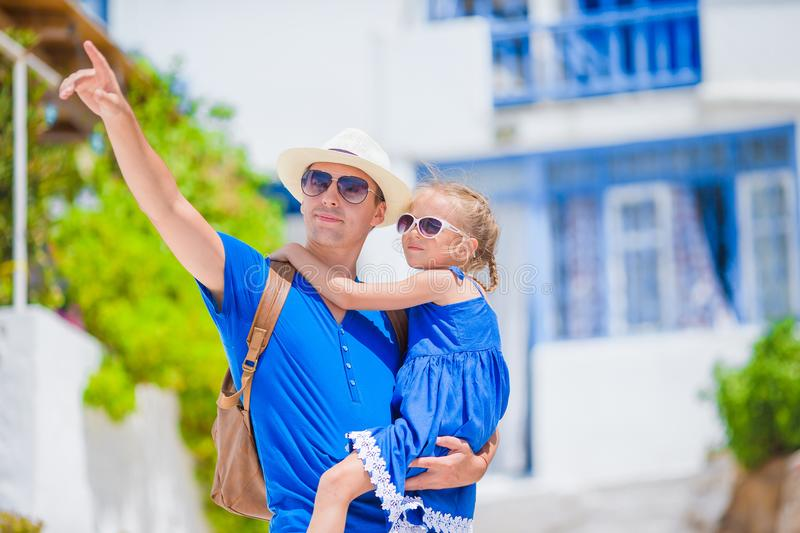 Family in Europe. Happy father and little adorable girl in Mykonos on summer greek vacation stock photography