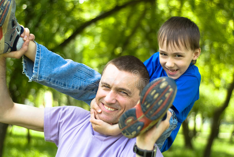 Happy dad with son. In a park royalty free stock images