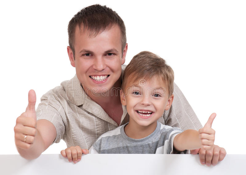 Happy dad and son. Portrait of happy dad and son with empty white board on white background royalty free stock photos