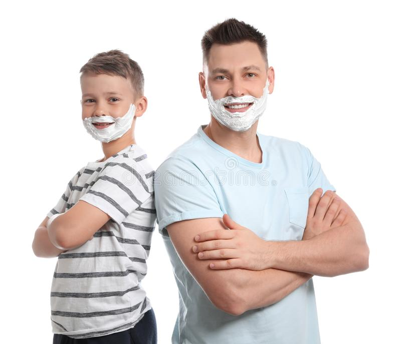 Happy dad and son with shaving foam on faces, white royalty free stock images