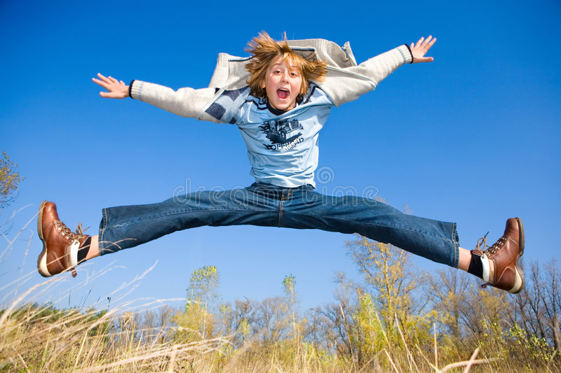Happy dancing boy. In jeans and coat stock photos