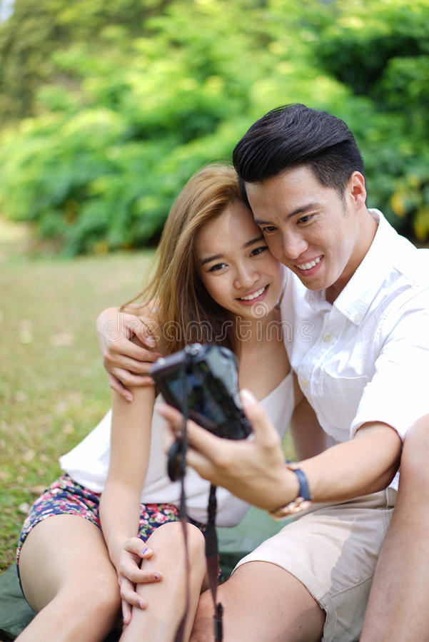 Download Happy Dating Couple Outdoor Picnic With Camera Stock Photo - Image  of smart, smiling