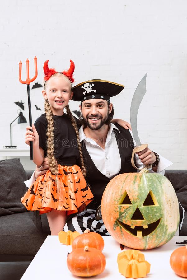 Happy daughter and father in halloween costumes. At home royalty free stock photography