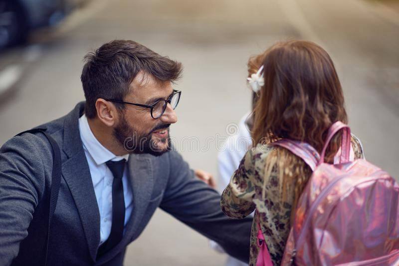 Happy day of back to school. father taking child to primary school. Happy day of back to school. Smiling father taking child to primary school stock photos