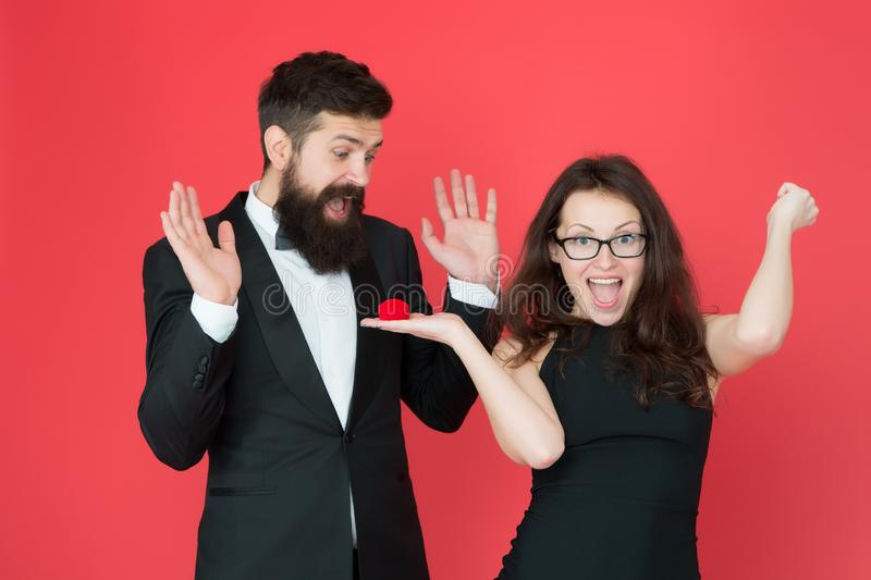 Happy day. woman make bearded man marriage proposal. love date and romance. valentines day. sexy couple in love. tuxedo. Happy day. women make bearded men stock photo