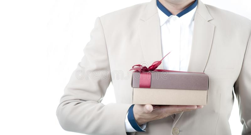 Happy day with happy young businessman looking romantic to give surprise gift box. Surprise with Gift boxes. Happy day with happy young businessman looking stock image