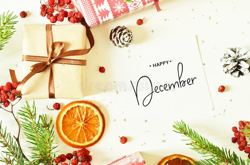 Happy December calligraphy inscription. Christmas decorations stock photography