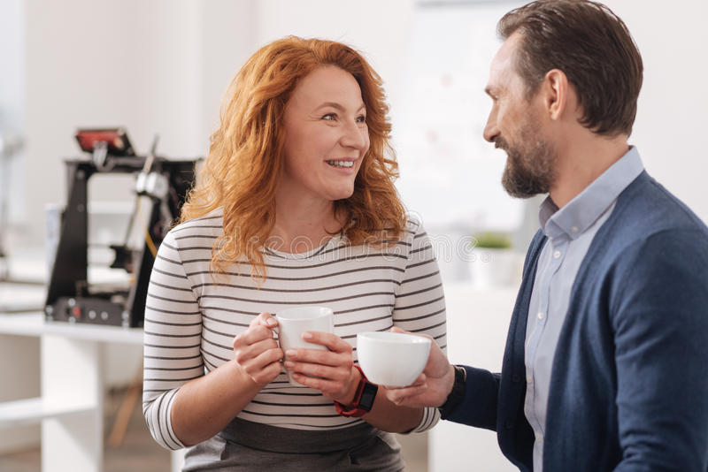 Happy delighted colleagues having coffee royalty free stock image