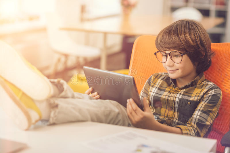 Happy delighted kid using a tablet stock images