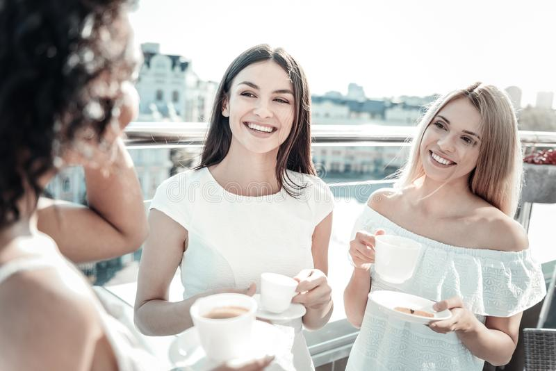 Happy delighted women listening to their friend royalty free stock image