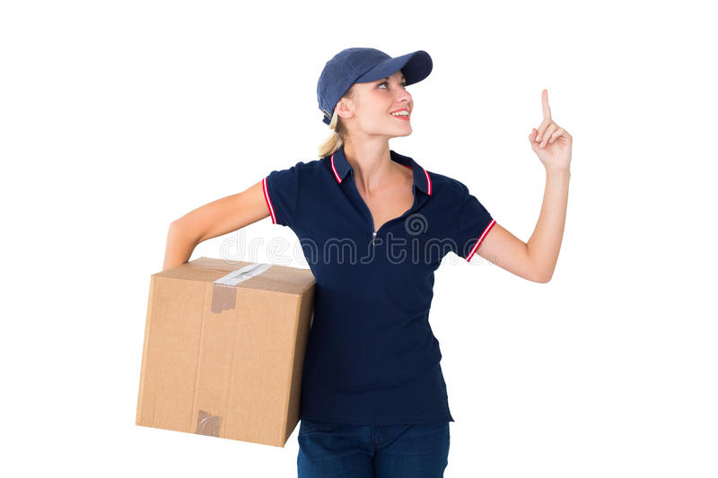 Happy Delivery Woman Holding Cardboard Box And Pointing Up Stock Photo