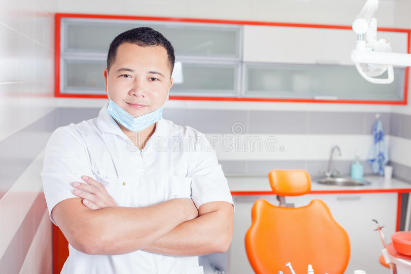 Happy dentist doctor at stomatological clinic. stock image