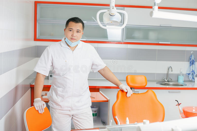 Happy dentist doctor at stomatological clinic. royalty free stock image