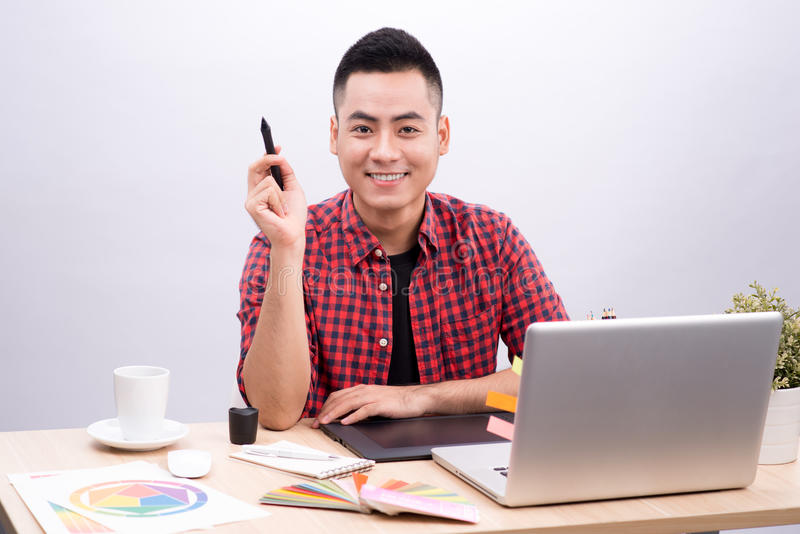 Happy designer working on his laptop in creative office royalty free stock photography
