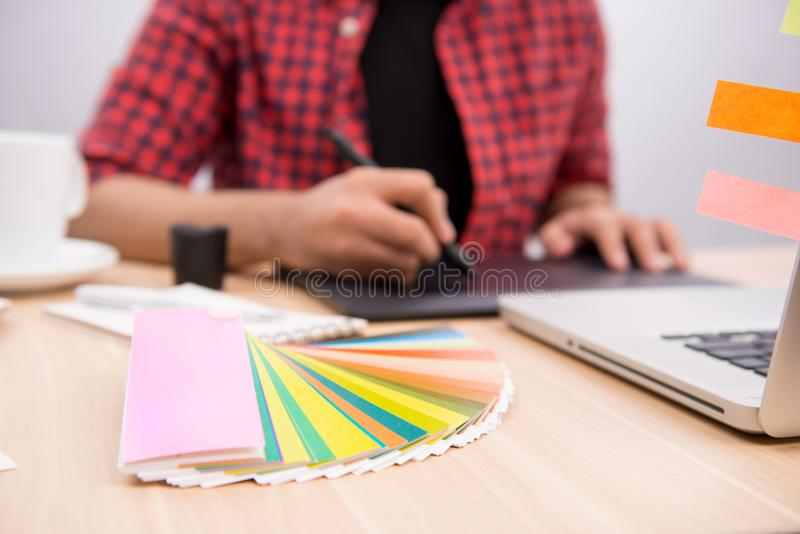 Happy designer working on his laptop in creative office royalty free stock images