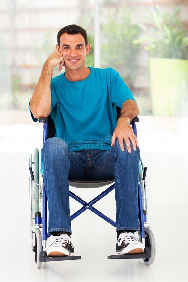 Disabled man wheelchair stock photo