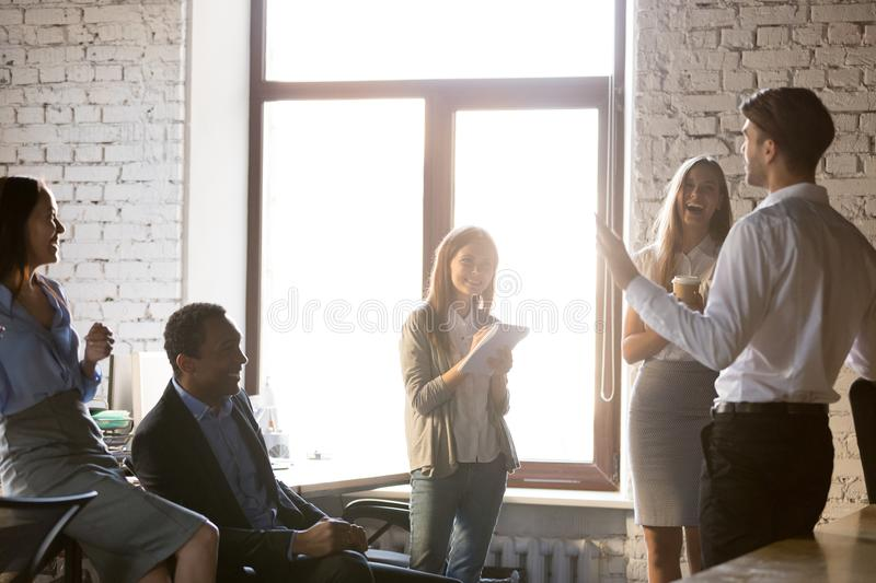 Happy diverse employees team with mentor having fun at meeting stock images