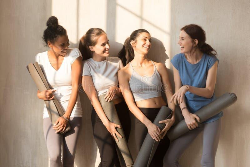 Happy female yogi have fun talking before training royalty free stock photos