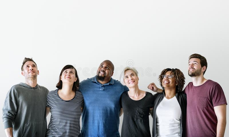 Happy diverse friends standing together royalty free stock photography