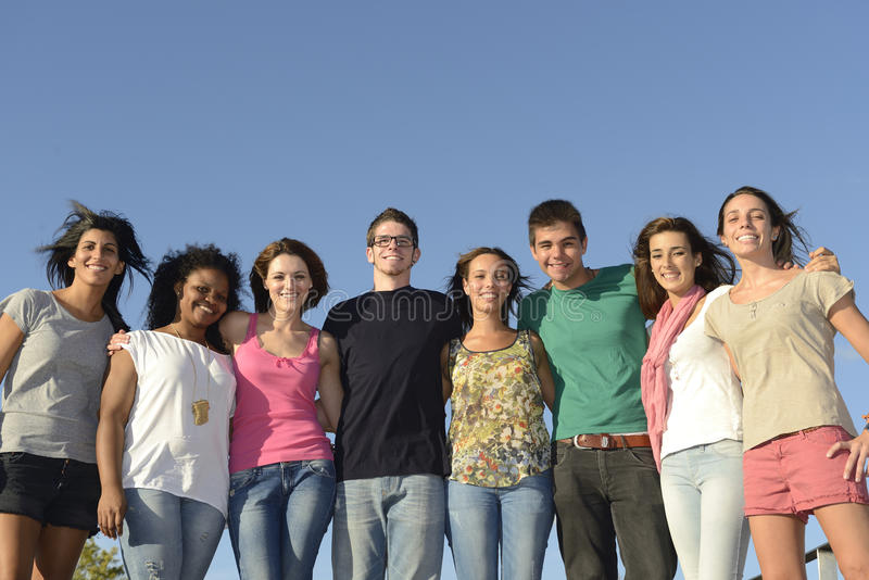 Happy and diverse group outdoors royalty free stock image
