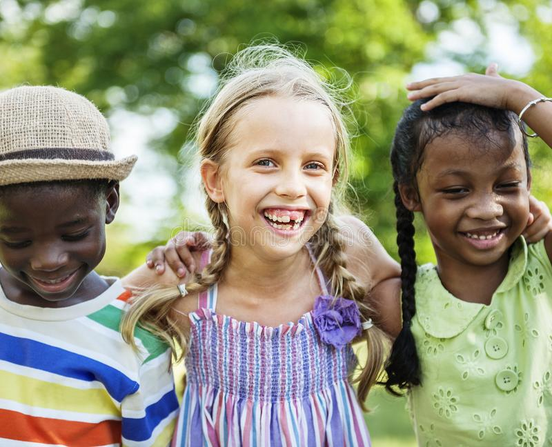 Happy diverse kids in the park royalty free stock photography