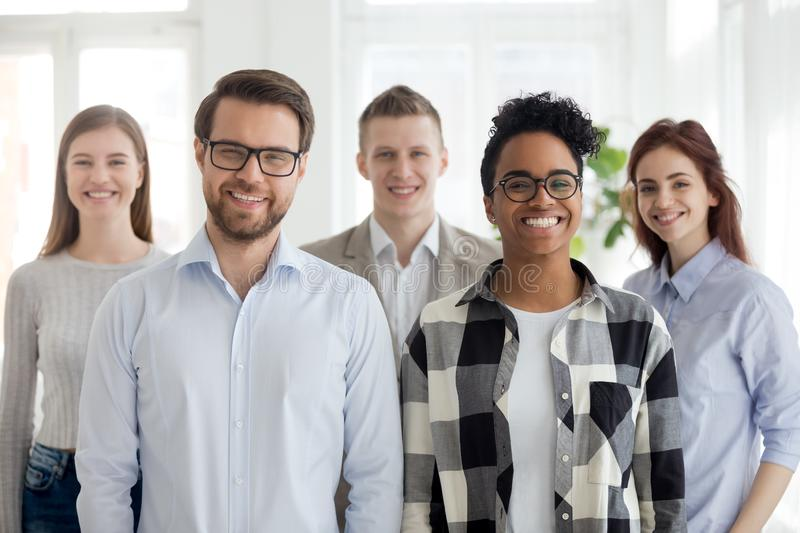 Multiethnic professional leaders and employees looking at camera, portrait. Happy diverse office workers group, multiethnic professional leaders and employees royalty free stock photo