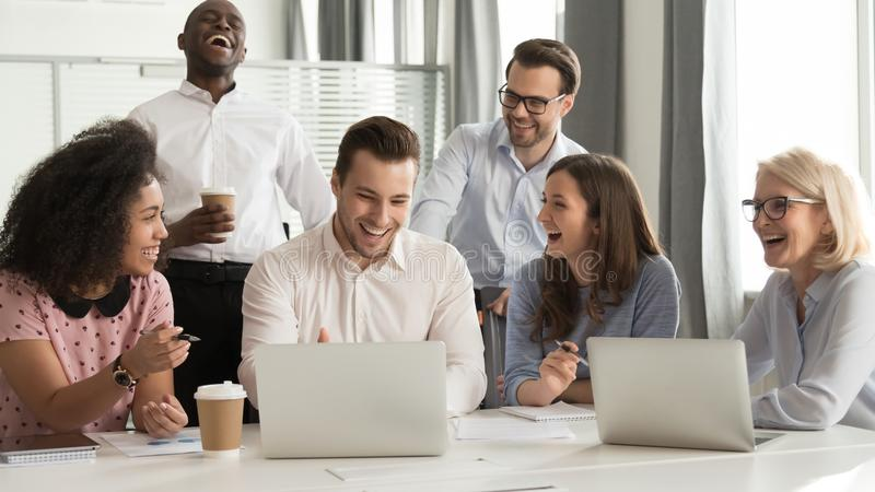 Happy diverse office workers team laughing together at group meeting stock photos