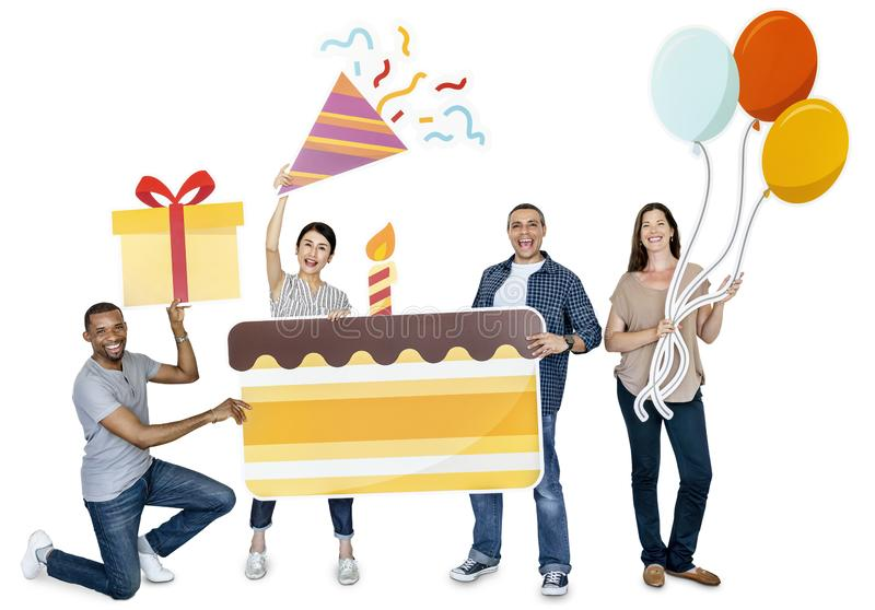 Happy diverse people holding birthday cake stock photos