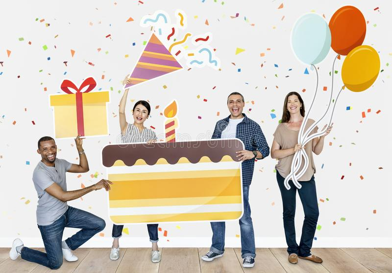 Happy diverse people holding birthday cake stock images