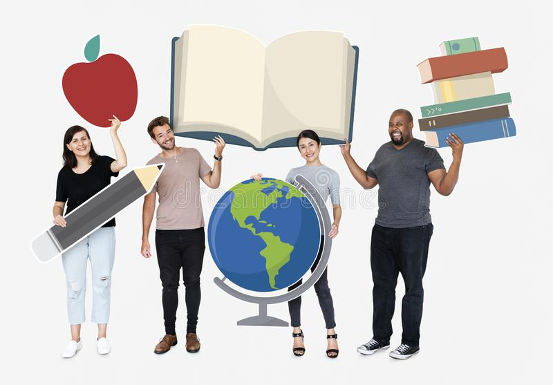 Happy diverse people holding educational icons stock photos