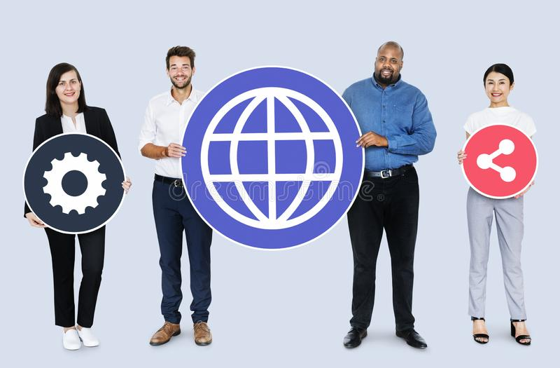 Happy diverse people holding internet icons royalty free stock image