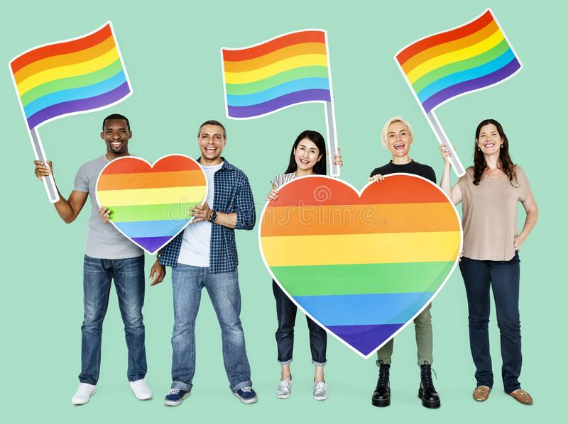 Happy diverse people holding lgbt hearts stock photo