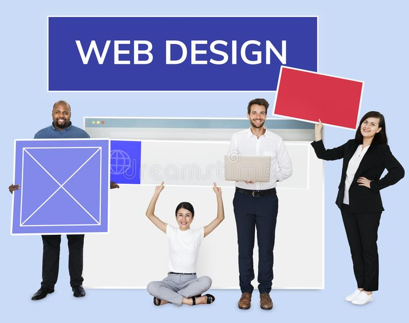 Happy diverse people holding web design board stock image