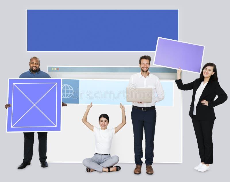 Happy diverse people holding web design board stock illustration