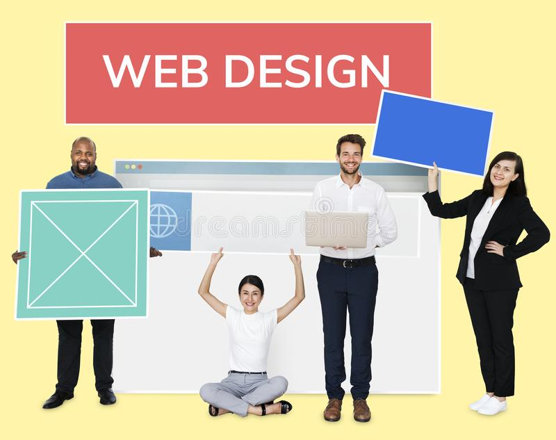 Happy diverse people holding wed design board stock photos