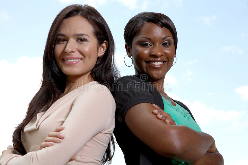 Happy diverse two women team royalty free stock photos