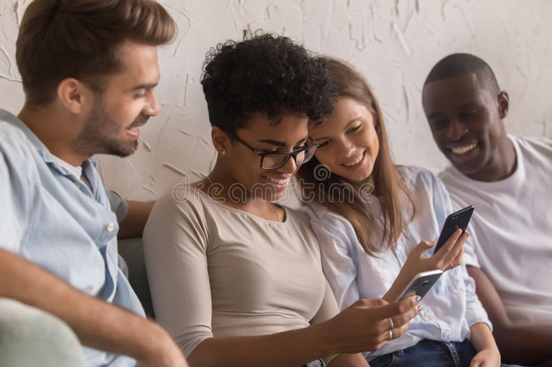 Happy diverse young people using social media apps on phones stock images