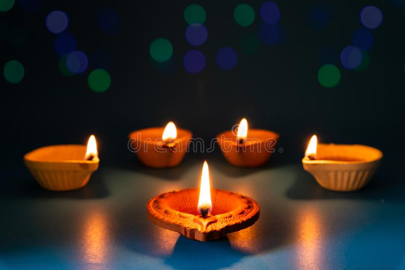 Happy Diwali - Clay Diya lamps lit during Dipavali. Hindu festival of lights celebration royalty free stock images