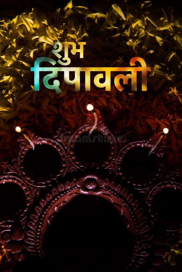 Happy diwali greeting card using traditional diwali diya over flower download happy diwali greeting card using traditional diwali diya over flower rangoli stock image image m4hsunfo