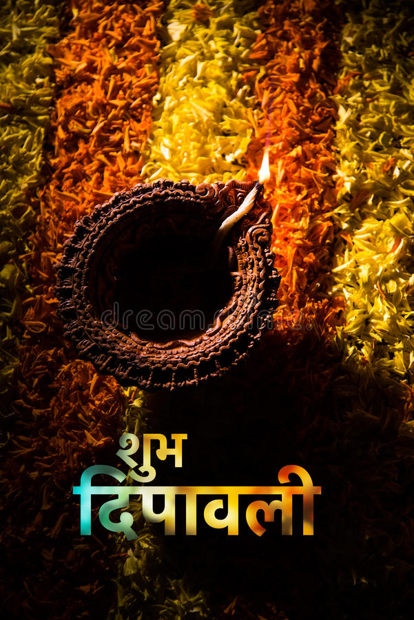Happy diwali greeting card using traditional diwali diya over flower download happy diwali greeting card using traditional diwali diya over flower rangoli stock photo image m4hsunfo