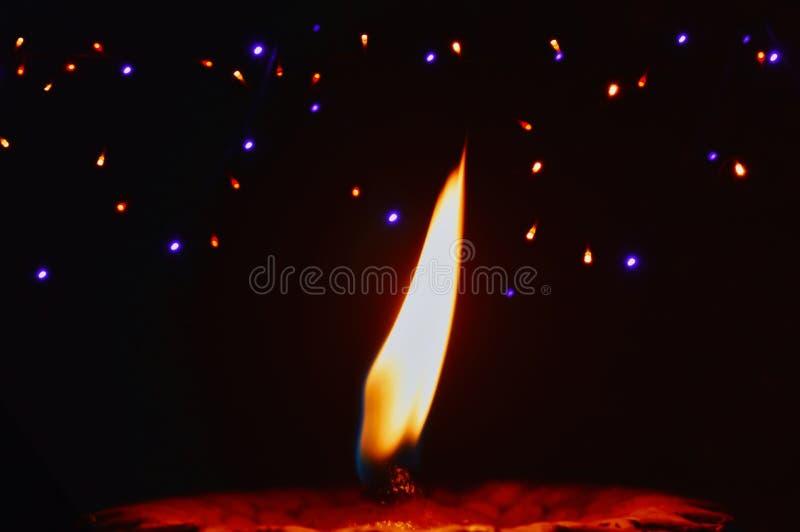 Happy Diwali  Lit diya lamp on street at night,oil lamp close up view,Hindu festival of lights celebration. Colorful traditional. Oil lamp diya on black stock photography