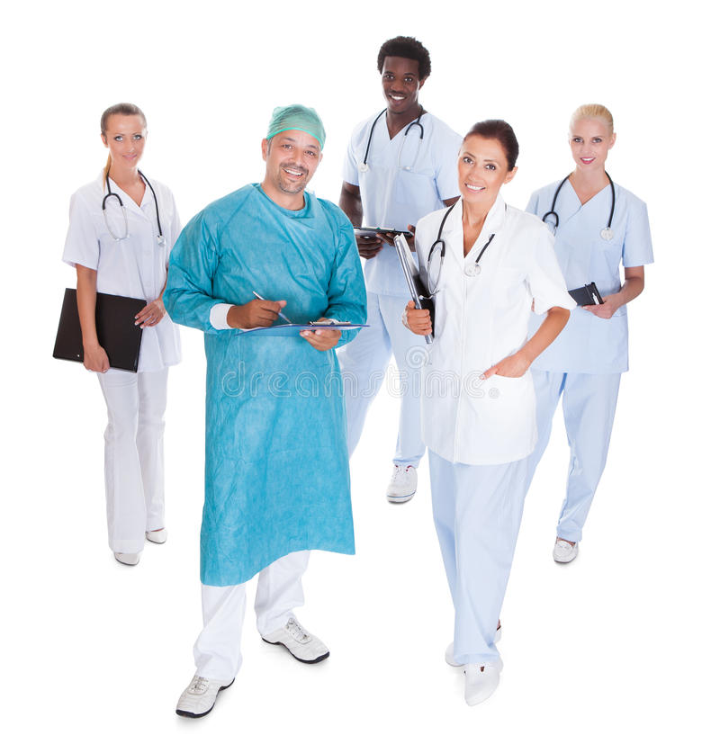 Free Happy Doctor In Surgical Gown With His Coworkers Royalty Free Stock Photo - 58561605