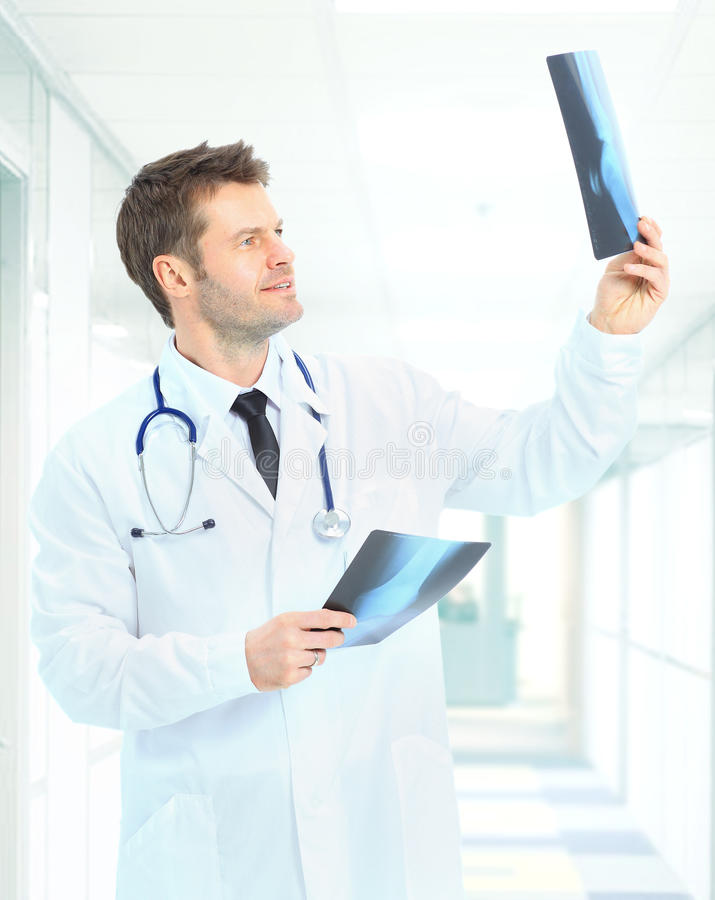 Download Happy Doctor Looking At X-ray Stock Photo - Image: 26372802