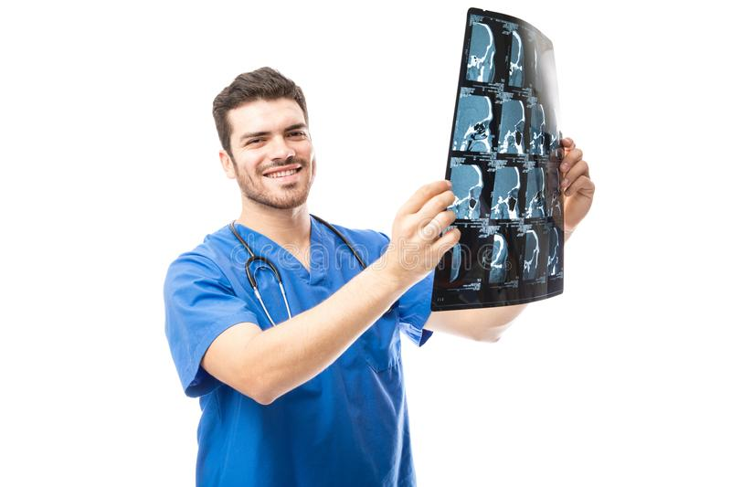 Happy doctor looking at x-rays royalty free stock photography