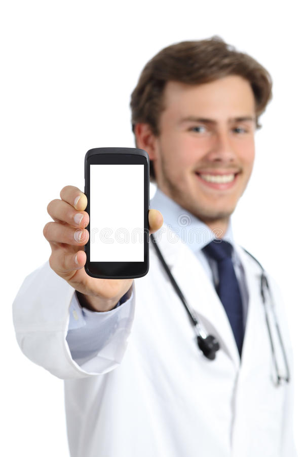 Happy doctor man showing a blank smart phone screen. Isolated on a white background stock images