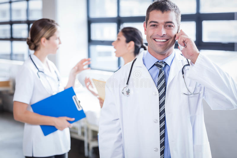 Happy doctor on the phone. In the hospital royalty free stock photos