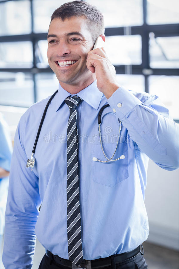 Happy doctor on the phone. In the hospital stock photos