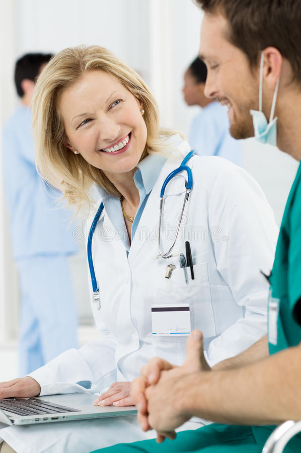 Download Happy Doctor Talking With Surgeon Stock Image - Image: 30882127