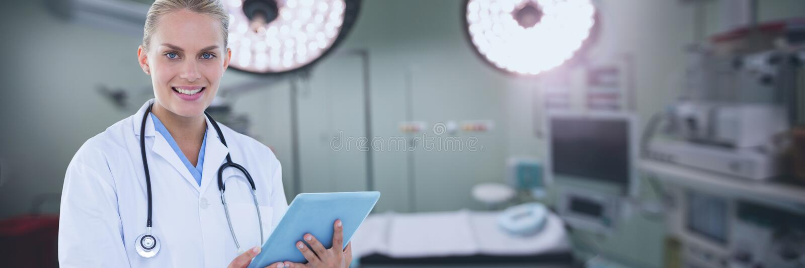 Happy doctor woman holding a tablet stock images