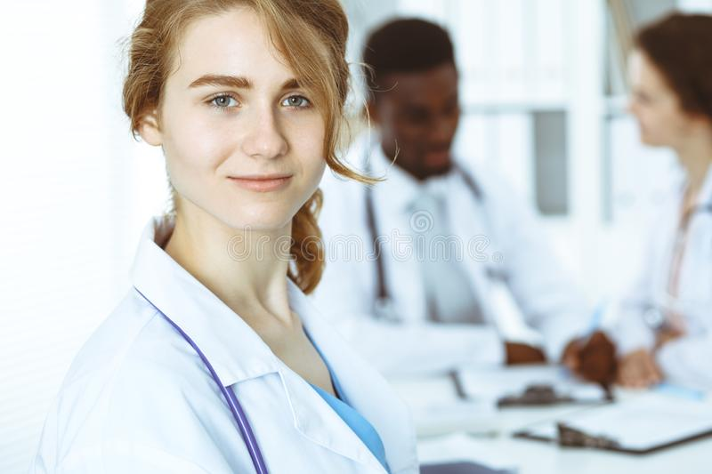 Happy doctor woman with medical staff at the hospital. Multi ethnic people group stock photo